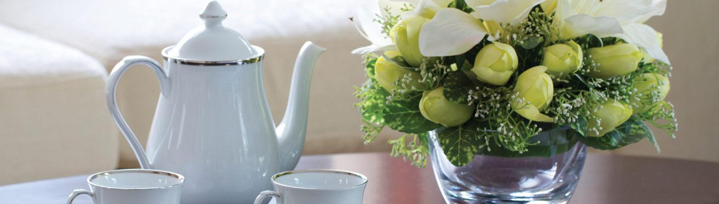 tea set next to flower setting