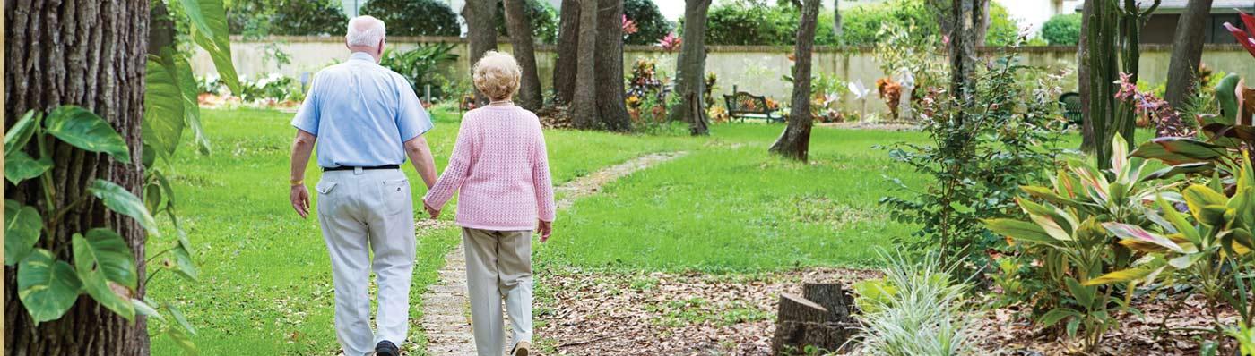 older couple walking the grounds at Eddy Senior Living community
