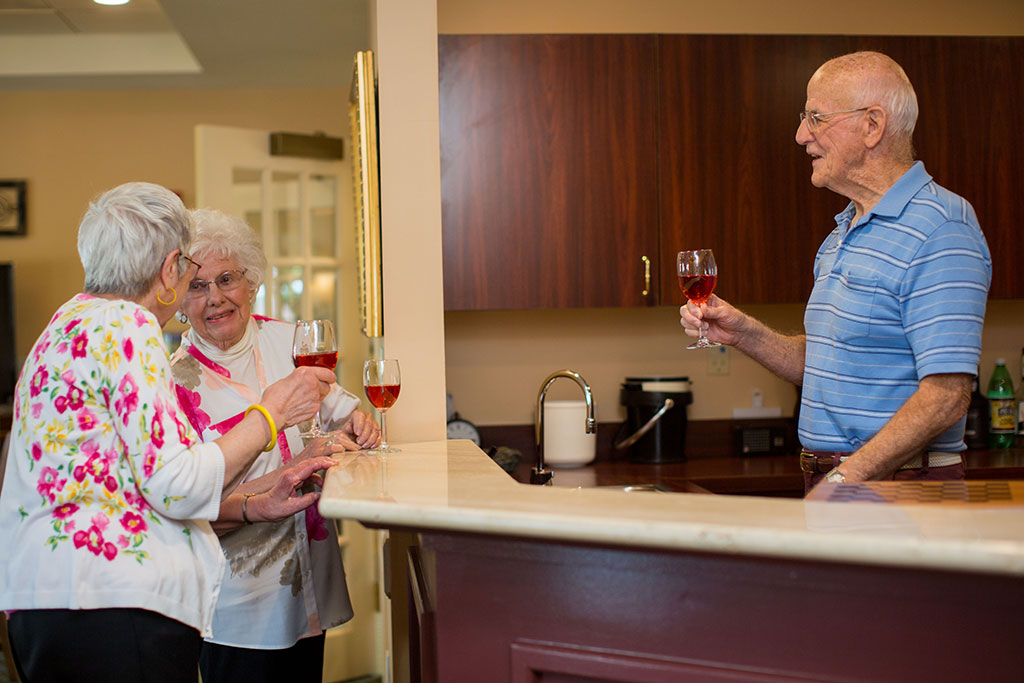 residents socializing at The Glen at Hiland Meadows