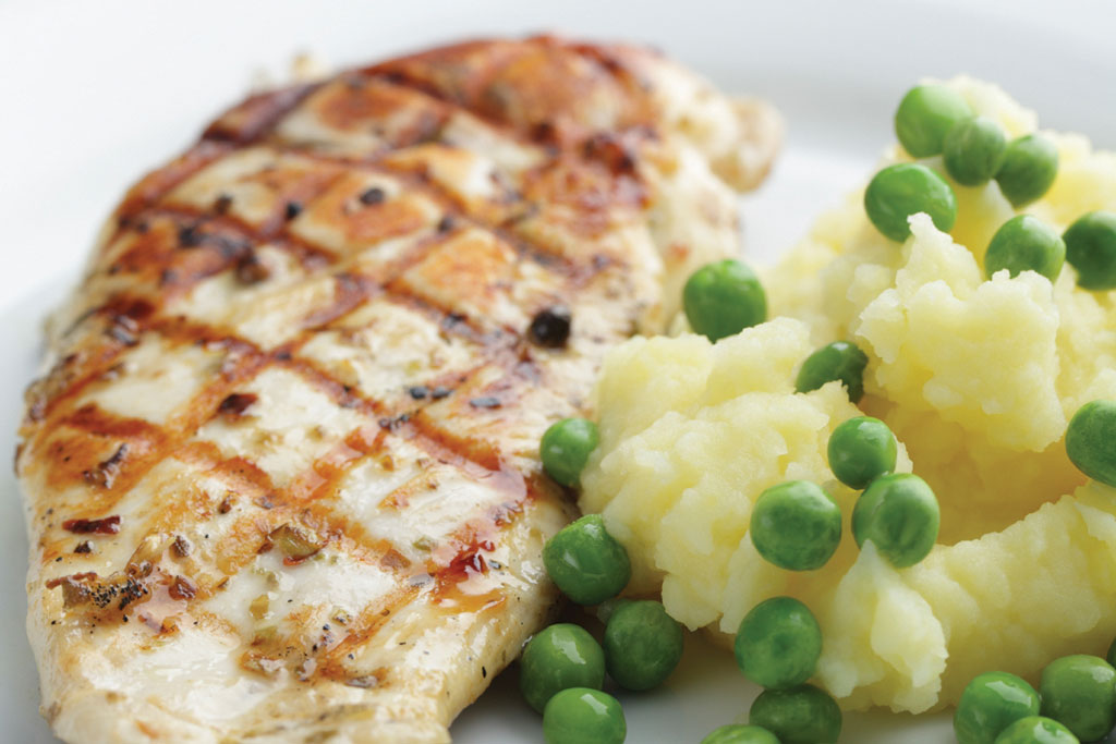 chicken, potatoes and peas meal prepared by chef