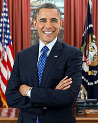 President Obama with crossed arms smiling
