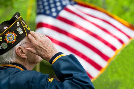 Veteran in front of a flag