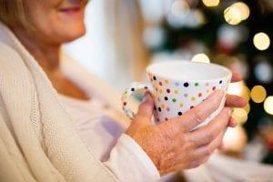 Senior holding mug