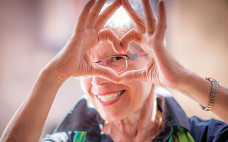 Woman making a heart shape with her fingers