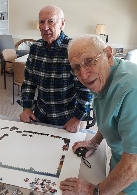Two residents doing a puzzle