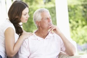 Adult Daughter Comforting Memory Impaired Father