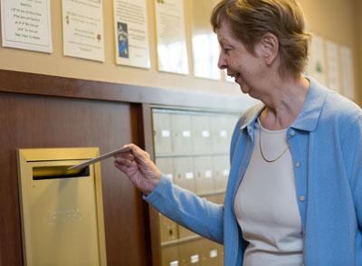 Senior mailing a letter