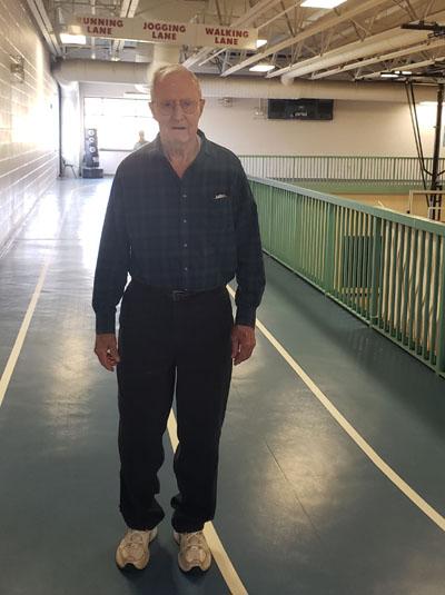 Senior man Indoors walking on the track