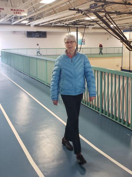 Senior woman walking on an indoor track
