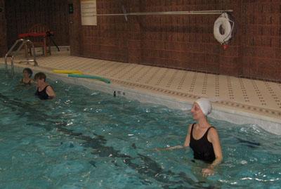Senior exercising in pool