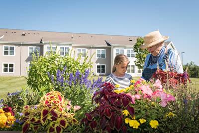 Senior gardening with granddaughter