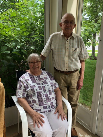 Marion sitting and ken standing next to her