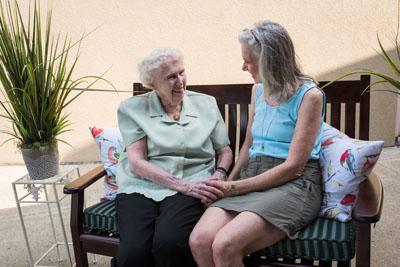 Two senior women friends conversing