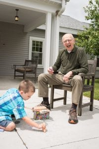 grandfather and grandson playing outside