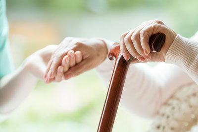 senior hands on cane