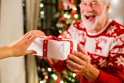Senior happily accepting a gift