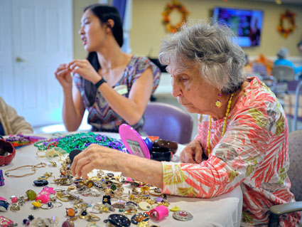 Senior woman with trinkets on table
