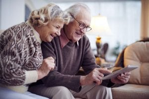 Senior couple networking at home