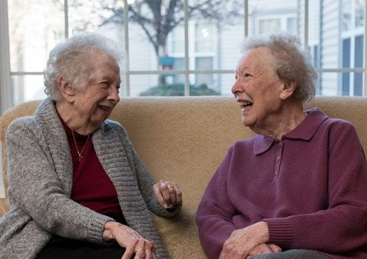 lady seniors laughing on couch
