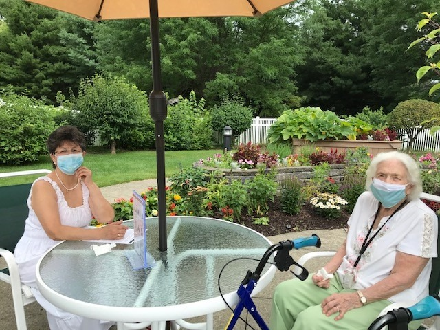 caregiver outside with mask