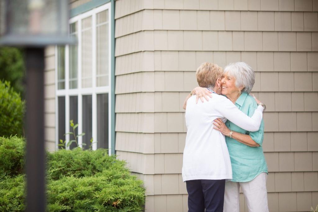 senior women embracing