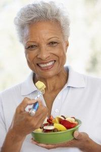 Senior eating fruit